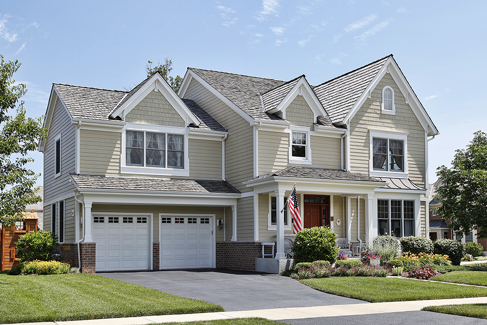 Suburban home with front porch and exterior coating